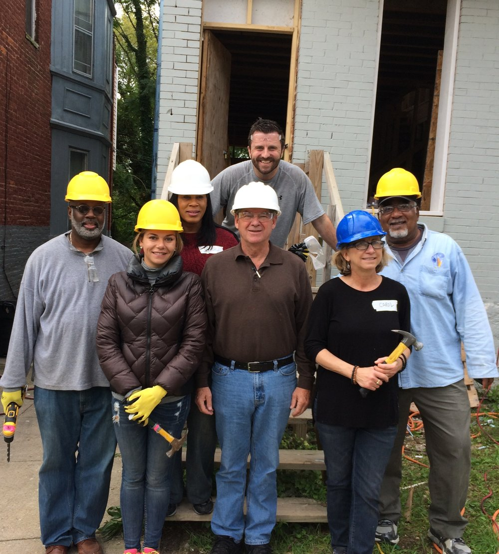 DHCD staff helping with Habitat for Humanity project