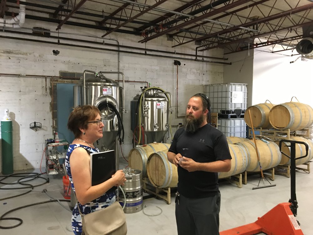 Tamar representing the State Commerce Department at House Cat Brewery in The City of Frederick