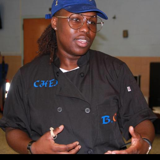 Founder and Head Chef Alisha Owensford talking o a group of middle school girls about Brooklynn Catering, LLC.