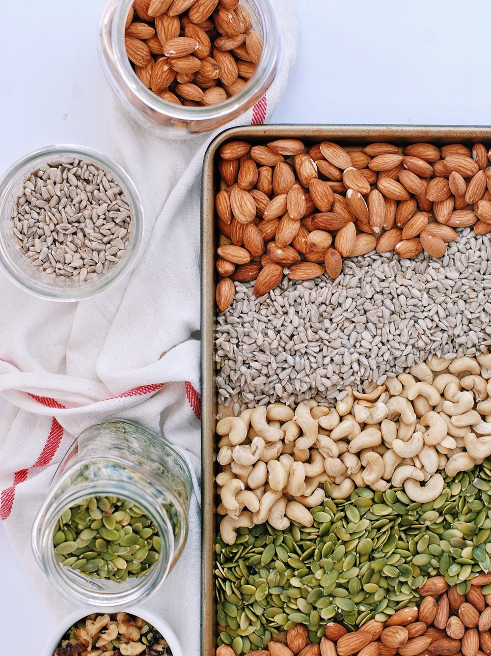 Your Guide to Soaking/Activating Nuts, Seeds, and Grains  - the how and why behind soaking nuts and seeds - Soaking your nuts and seeds have so many benefits for your health! Dehydrating them also make the most delicious crispy nuts! - Foody First - #paleo #vegan #nutsandseeds #whole30 #whole30snacks #wellness #holistichealth #keto #healthyfats