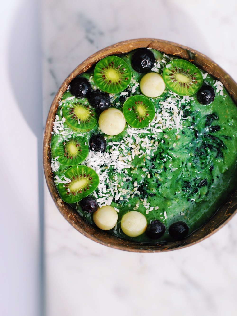 Pear, Spirulina, Spinach Smoothie Bowl - All about Spirulina (such an amazing superfood), but also why you don't NEED it to be healthy. Living well starts small. Small changes in your lifestyle, making changes to things that leave you feel energized and joy-filled, loving on others. Start there. Extras can come later!  - Foody First  - #wellness #healthy #smoothiebowl #smoothie #greens #eatyourgreens #raw #paleo #vegan #plantbased #spirulina #whole30 #nutritiontips #nutrition #glutenfree