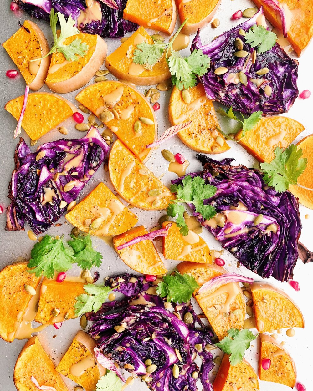 Roasted Butternut Squash and Red Cabbage with Lemon-Miso-Maple Dressing - Add chickpeas to this sheet pan dinner and you're set! foody first - vegan, gluten free, paleo (if not using the chickpeas) #vegan #plantbased #glutenfree #dairyfree #paleo #sheetpan #sheetpandinner #butternutsquash #butternut #cabbage #easydinners