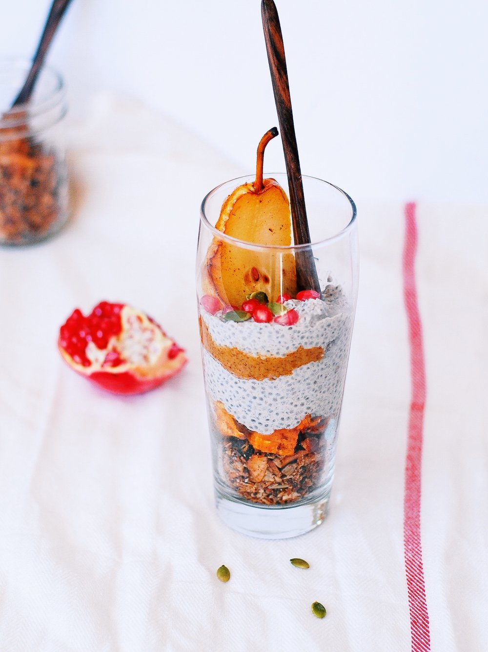 delicious layers of chai spiced grain-free granola + chia pudding+roasted cinnamon-y sweet potatoes+ almond butter + roasted pear+ seeds + pomegranates! Fall goodness to the max!