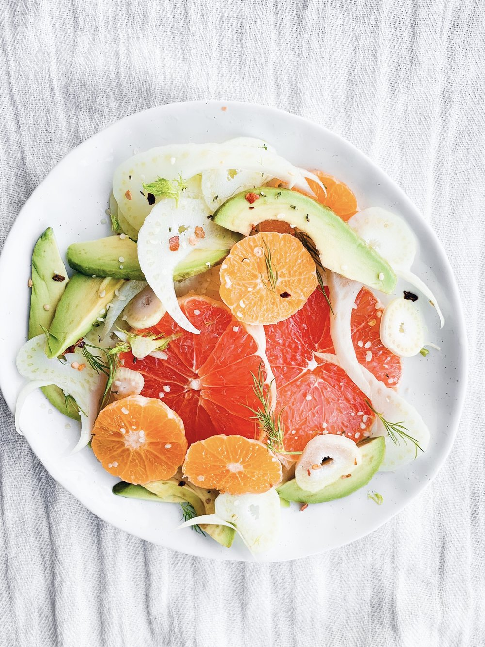 Sunshiney Avocado, Fennel and Grapefruit Salad - the perfect energizing, refreshing, seasonal salad to enjoy in the winter time (but really it's good anytime!)! Foody First Beth Bierema - #vegan #plantbased #raw #glutenfree #whole30 #paleo #citrus #fennel #avocado