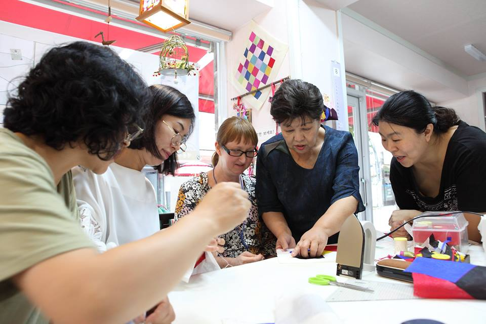 Bojagi class in Suwon - Teacher, Na Jung-Hee in her studio in Suwon, demonstrating to me how to insert the central square to my Bojagi covering cloth.