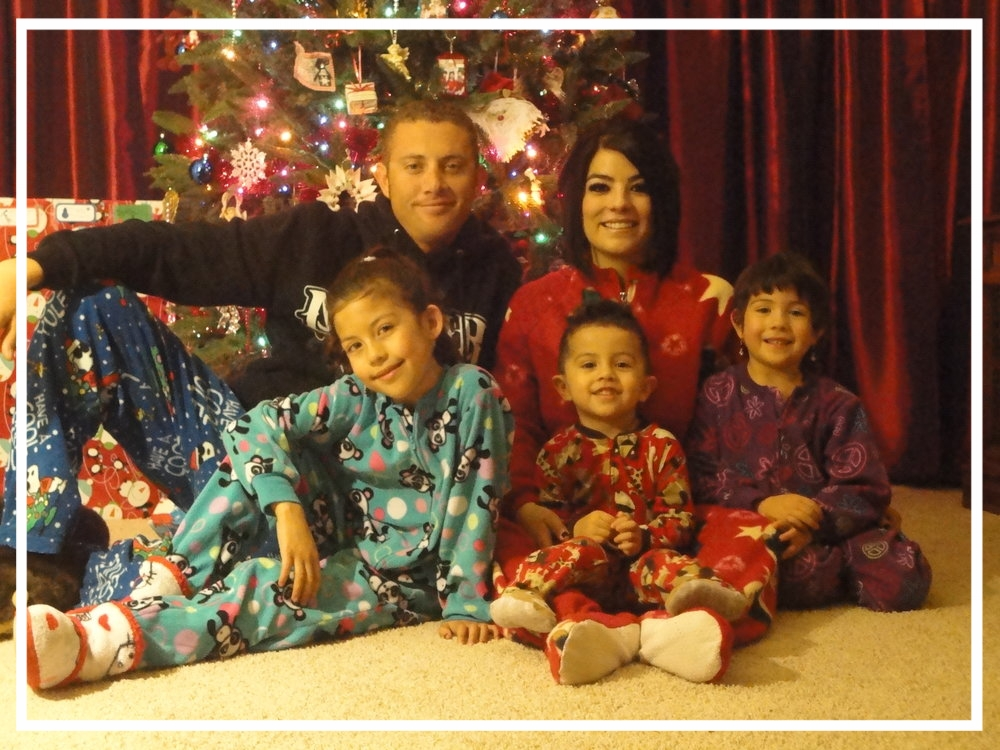 Officer Dominique Perez with his wife and three children