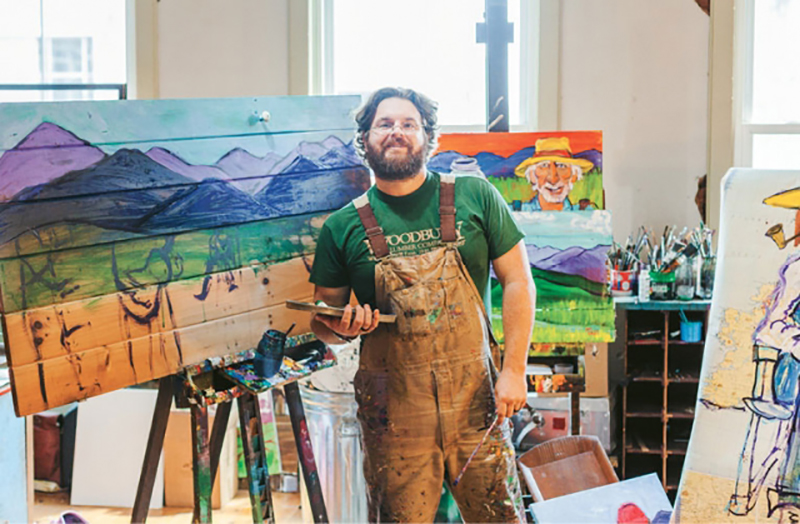 FOLK STORY: FOR LENOIR ARTIST CHARLIE FRYE, COMMUNITY FUELS THE CREATIVE SPIRIT - CLICK TO READ THE FULL ARTICLE: Charlie Frye is hard to miss. A tall, burly fellow with a full beard and ponytail, he walks the streets of downtown Lenoir with his purple owl coffee mug in hand, wearing acrylic-stained duck bib overalls. Cars honk and passengers wave as they drive by. Frye,  who is a self-trained folk artist and knows most everyone in town, cheerily calls out each driver's name, spilling some of his coffee as he waves back...