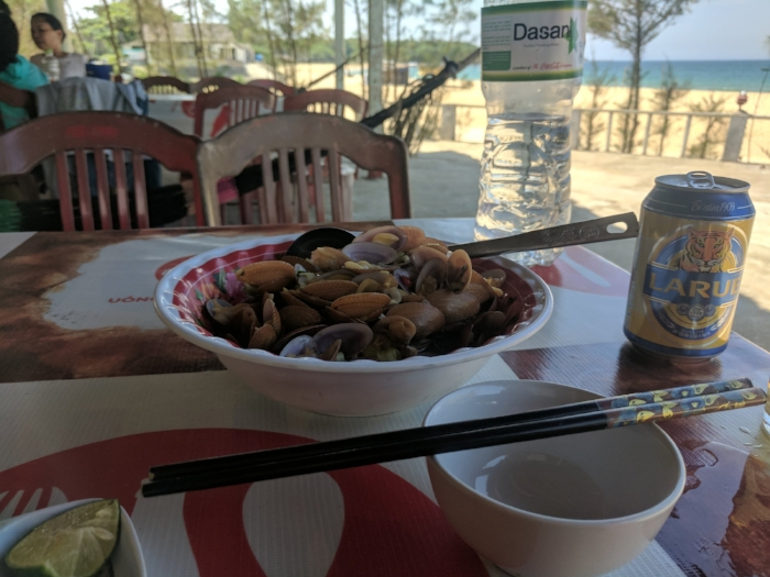 My dad served in the Vietnam/American War. On a 7-week motorcycle tour thru Vietnam, here I sit in a shell of time: his former military base now a row of seafood restaurants. At a place that caused him pain, fear, comradery, and god knows what, I nourish my heart (and stomach). The daily special? Vietnamese Clams. After returning to the USA, my dad started a Clambake and BBQ catering company. With just one 'butterfly effect' of a bullet, this serendipitous moment (and every moment) could all have vanished like a popped balloon. Ohh such delicious clams.