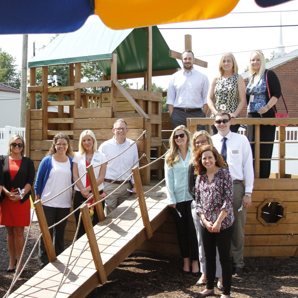 The Rotaract Club of Evansville renovated Ark's playground as its first-ever Signature Project! The former parking lot was transformed to have grass, a hill slide, trees, a tricycle trail and much more!