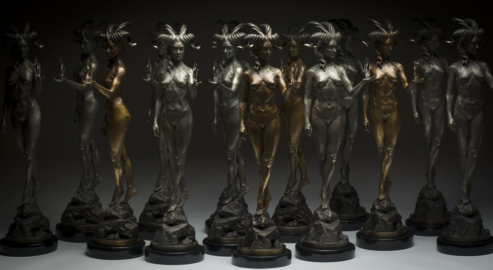 "Colin and Kristine Poole from KC Poole Studios,  The Spectrum Muse Award , 2015. Bronze, sterling, silver, 24K gold, marble, 16"" × 6"" × 5"".  Photo: Colin Poole."