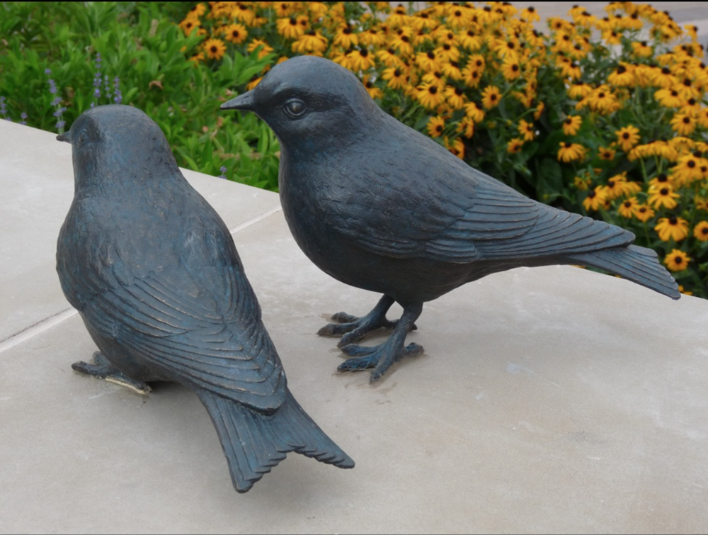 MGA Sculpture Studio, Mark Aeling, Mountain Blue Birds. These sculptures represent the state bird of Nevada and are placed in a plaza so that they can be engaged with by the public. MATERIALS: Bronze DIMENSIONS: .3 Ft. W X .5 Ft. H X 1 Ft. Deep