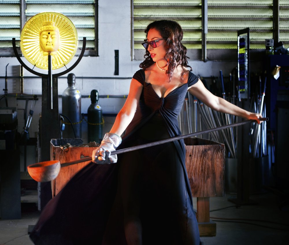 It takes a pretty tough lady to work with hot glass in a little black dress!