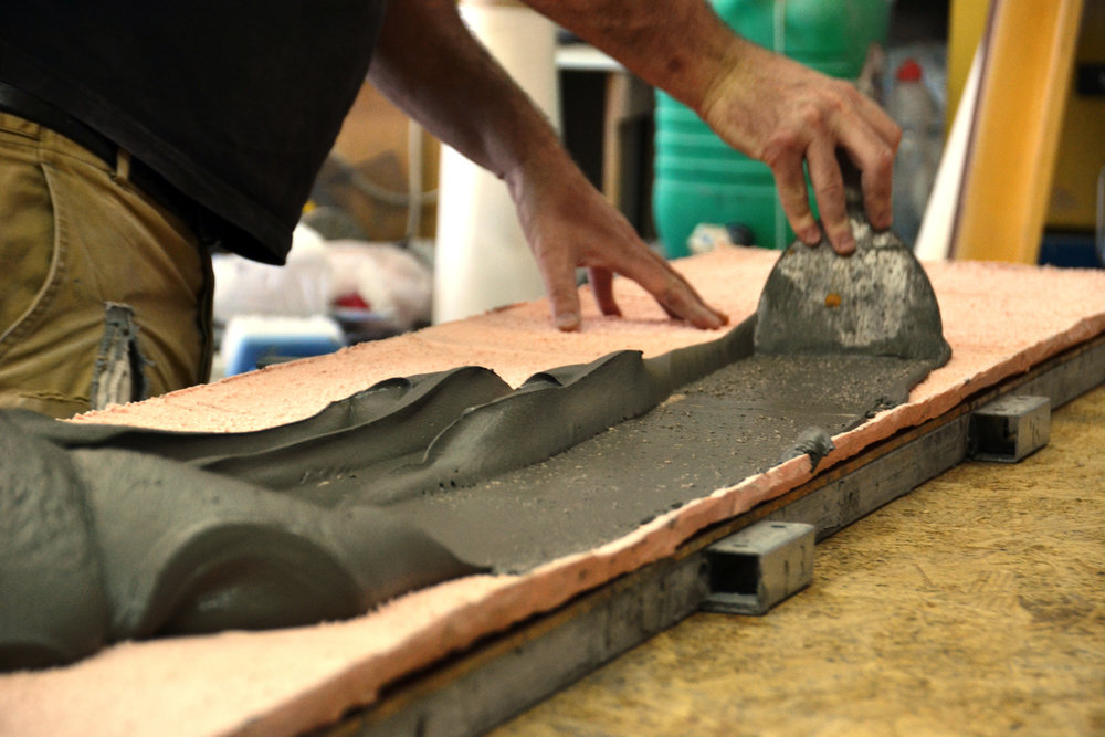Fenichel spreads thickened sement with a trowel onto a flat silicone mold. Photo by Doron Kuperman, courtesy of the artist.