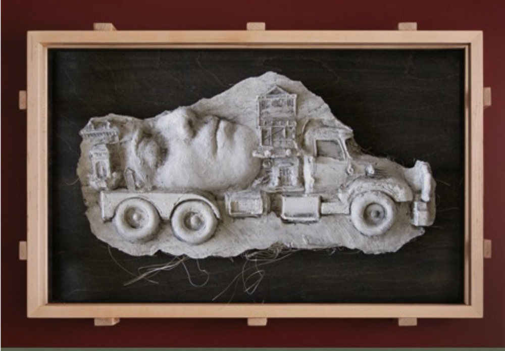 "Leslie Fry. Onward. Ink on plaster (cast from clay mold), maple frame. 13"" x 20"" x 2.5"""