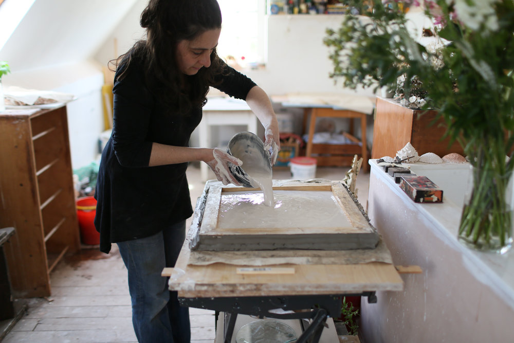 A wood frame is placed around the clay waste mold and then Rachel pours plaster into the cavity. Photo by Gerard Wiseman, courtesy of the artist.