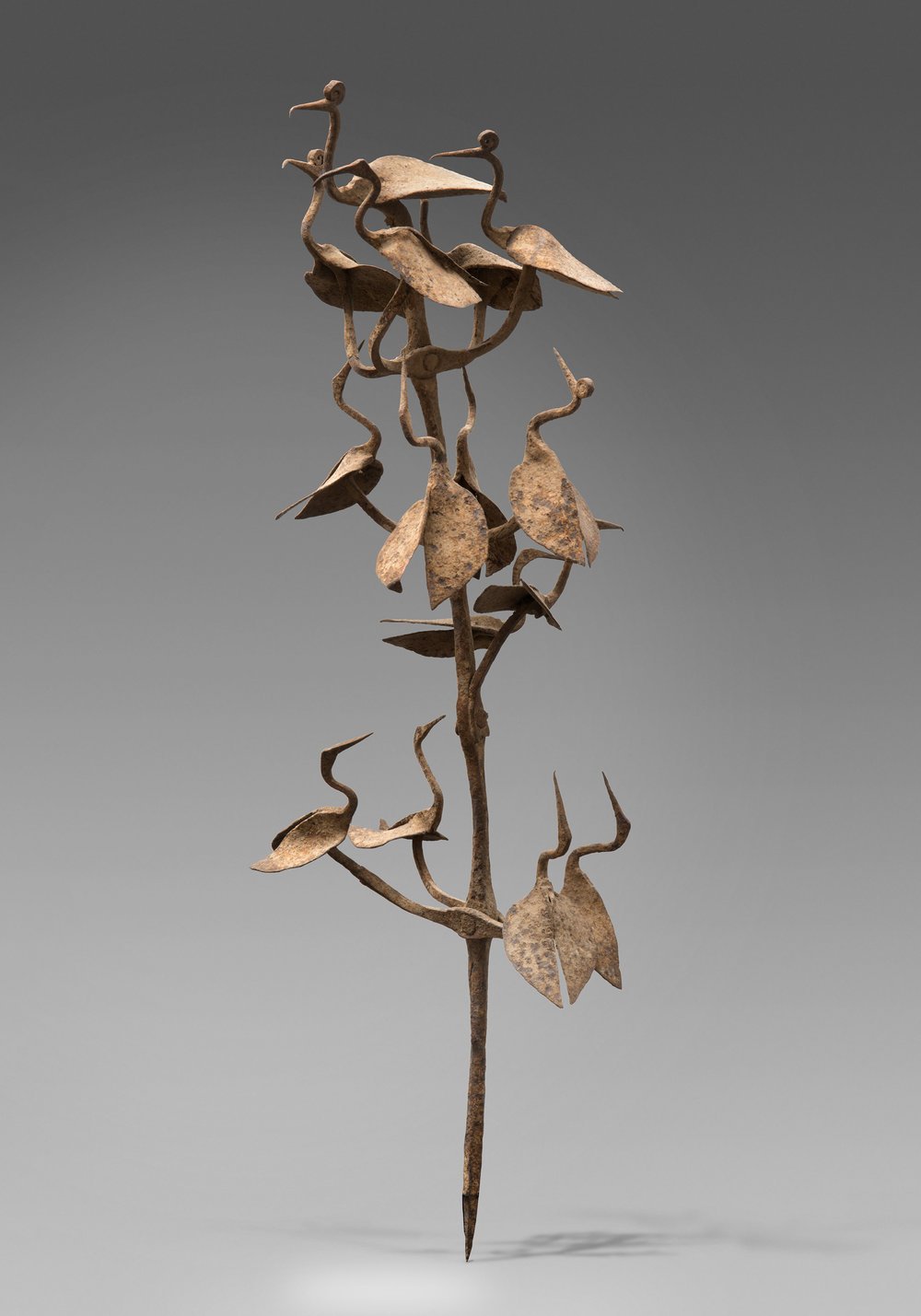 Artist Unknown (Yorùbá peoples, Nigeria), Herbalist's Staff (ọ̀pá Ọ̀sanyìn), 19th century, forged iron, H: 61.5 cm, Diam: 17.5 cm. Collection Mina and Samir Borro. Image © courtesy Mina and Samir Borro