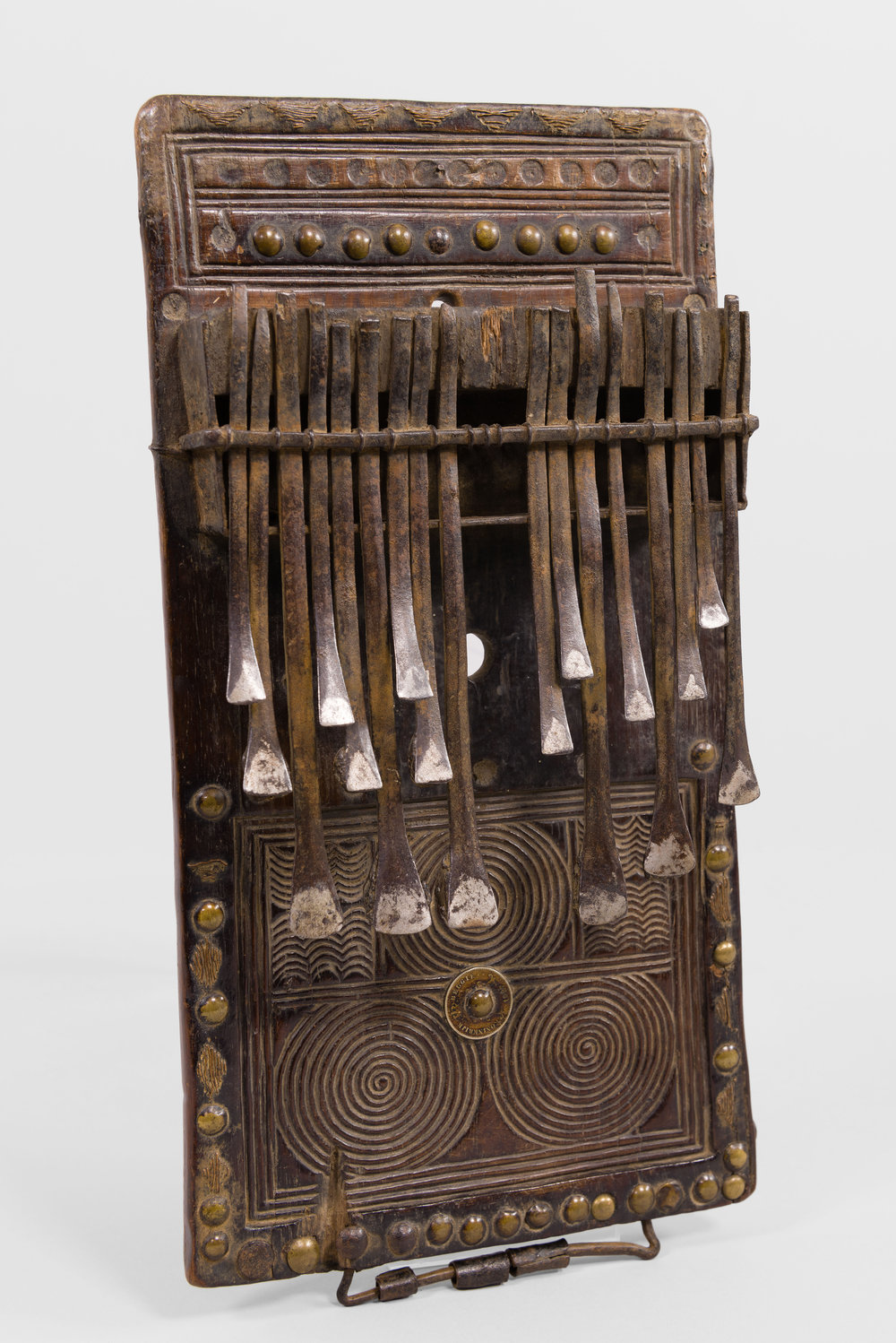 Artist unknown (Chokwe peoples, Angola), lamellophone (chisanji), late 19th century, wood, iron, H: 36.2 cm, W: 18.7 cm, D: 5.1 cm. Musical Instrument Museum 2013.56.1. Image © Musical Instrument Museum. Photograph Troy Sharp, 2016