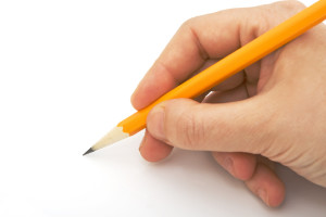 writing with pencil isolated against white background