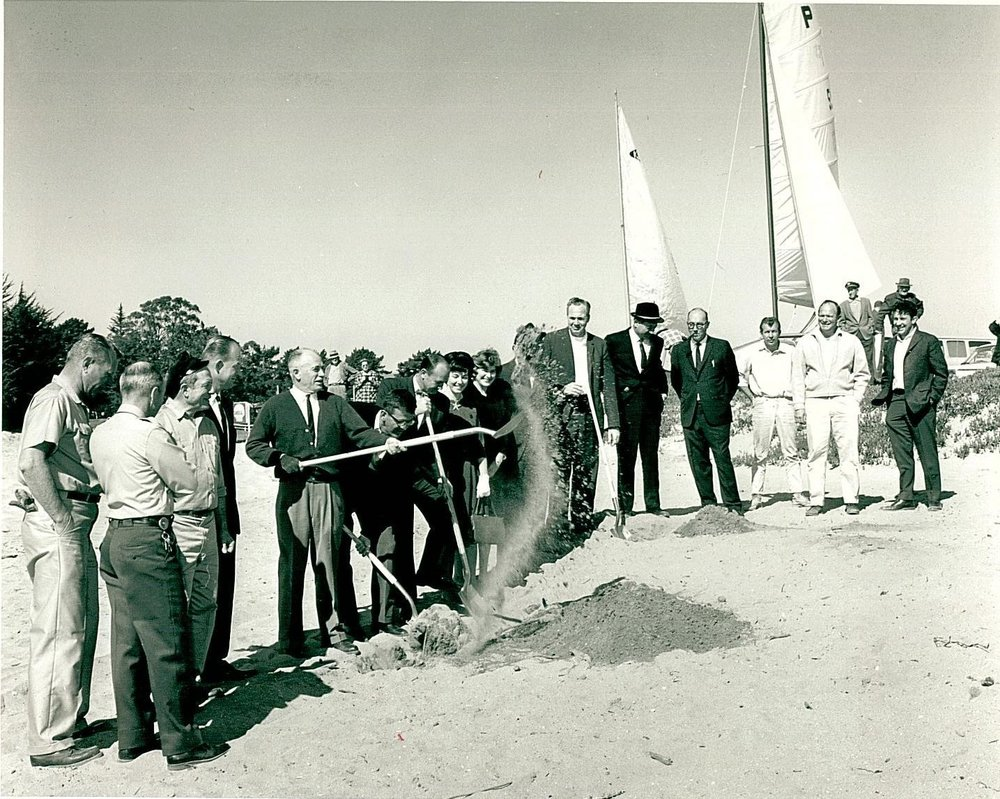 O'Neill Building Groundbreaking - Circa 1965  Left to Right:  Port Commissioner Malio Stagnaro (in hat), Port Commissioner Worth Brown (with shovel), Port Commissioners Don Falconer (w/ shovel), Scotchie Sinclair, Editor of the Sentinel, Port Commissioner Al Haber (brim hat), Vern Allen, yacht broker (in light windbreaker), Jack O'Neill (in suit coat).