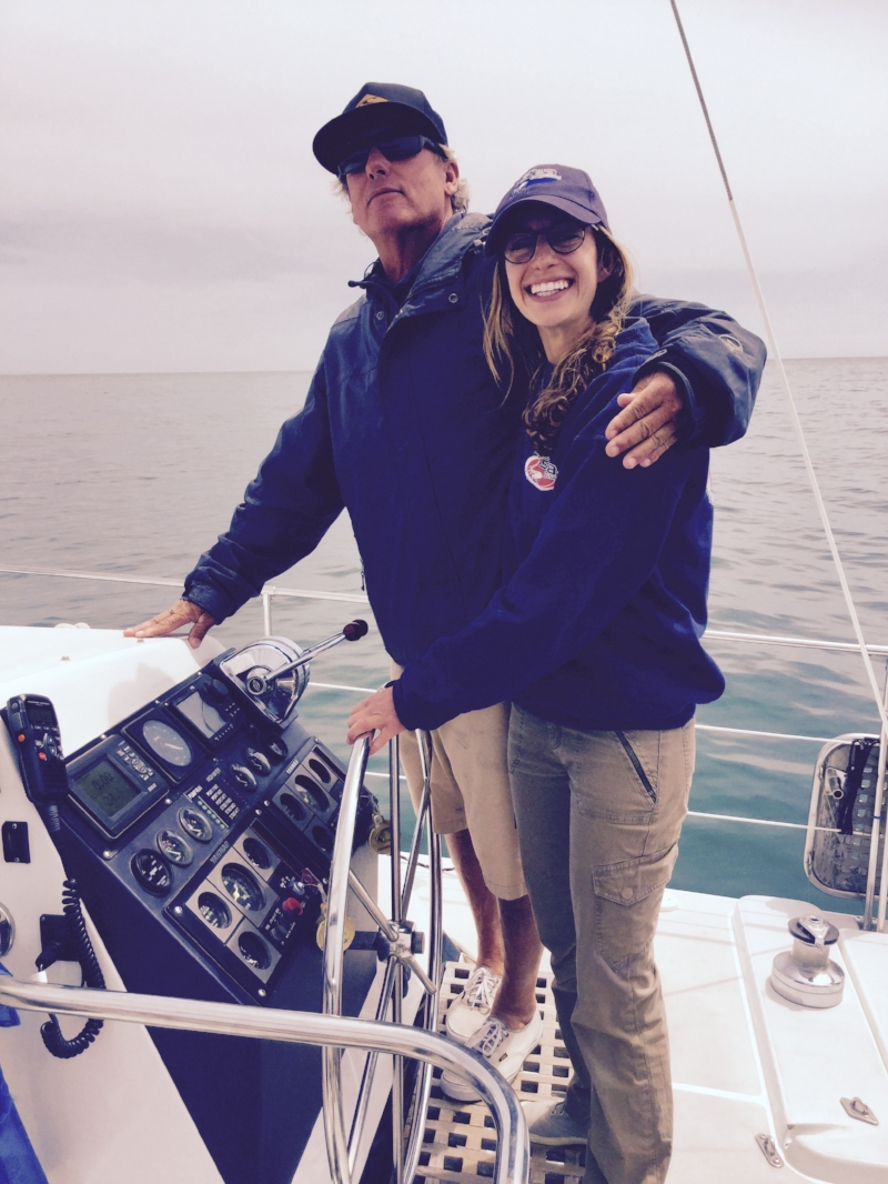 OSO Captain, Mike Egan, at the helm with Abby.