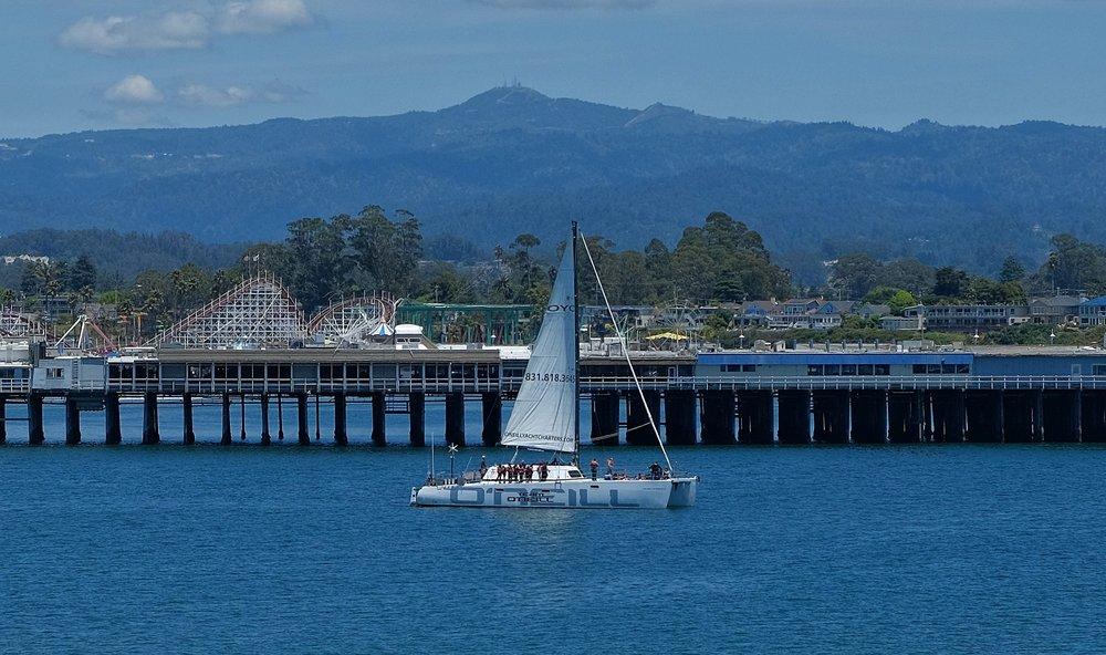 O'Neill Sea Odyssey students in class aboard the Team O'Neill catamaran as it sails along the Santa Cruz Wharf. Photo courtesy of Rick Oliver.