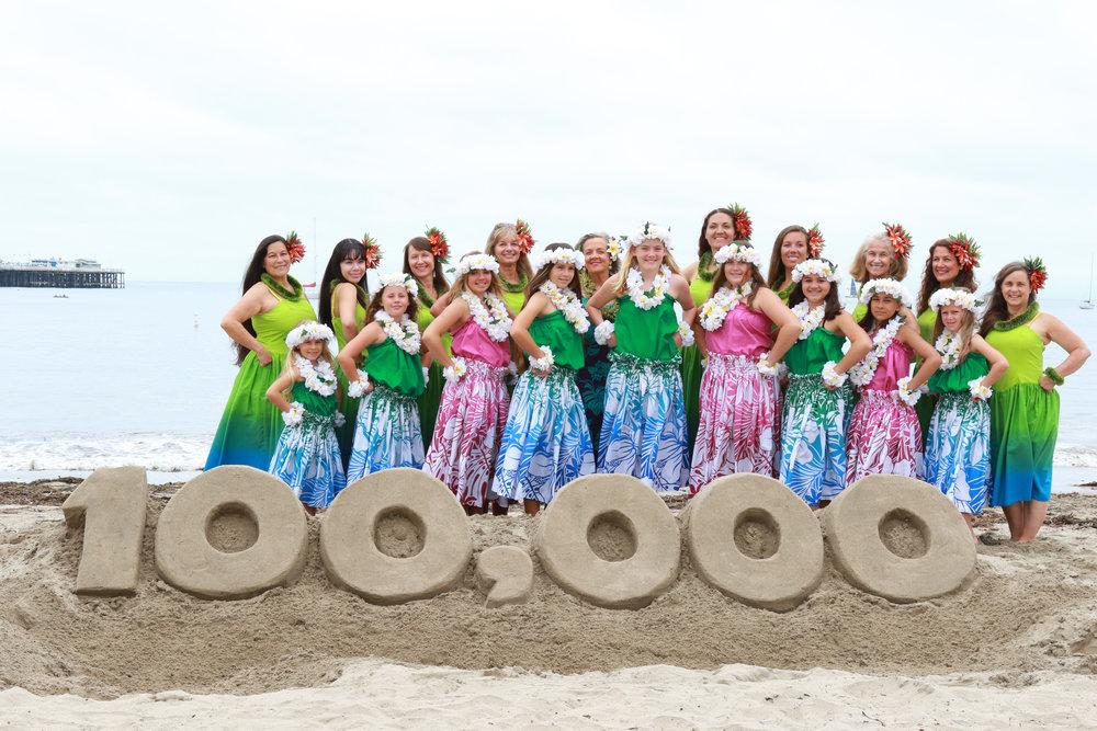 "Te Hau Nui dancers pose behind Santa Cruz Sand's ""100,000"" creation. Thank you, Bill, for your amazing sand sculpture."