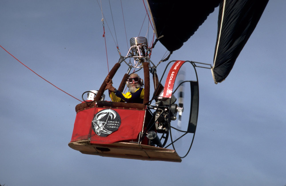 """Jack O'Neill soaring above in his """"Air Ship""""."""
