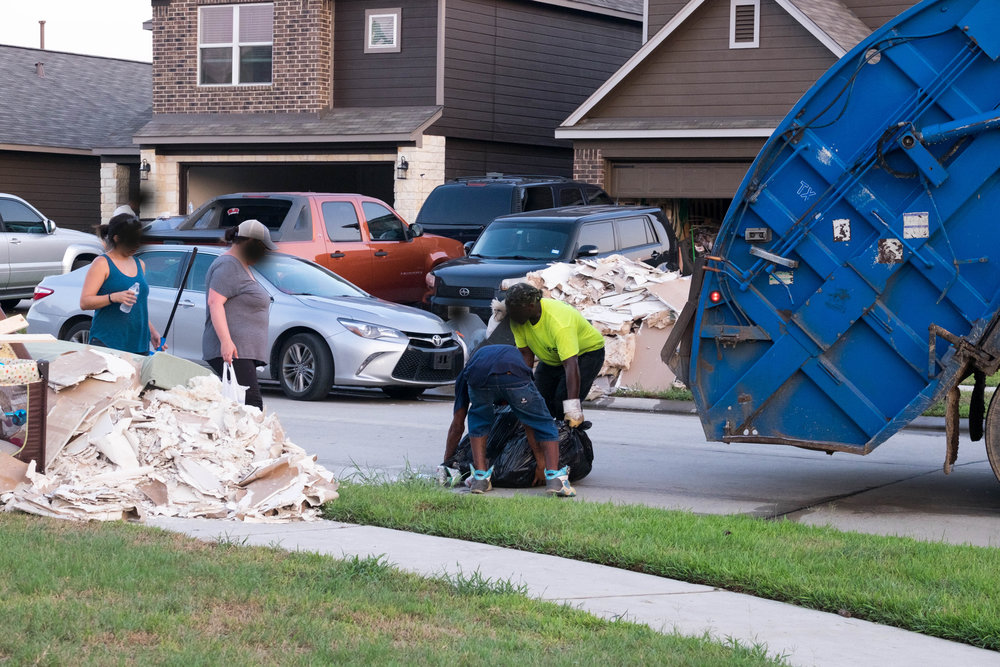 Local trash crews weren't allowed to pick up anything but the usual household trash leaving people wondering how they were going to handle the leftover refuse of tearing out their homes.