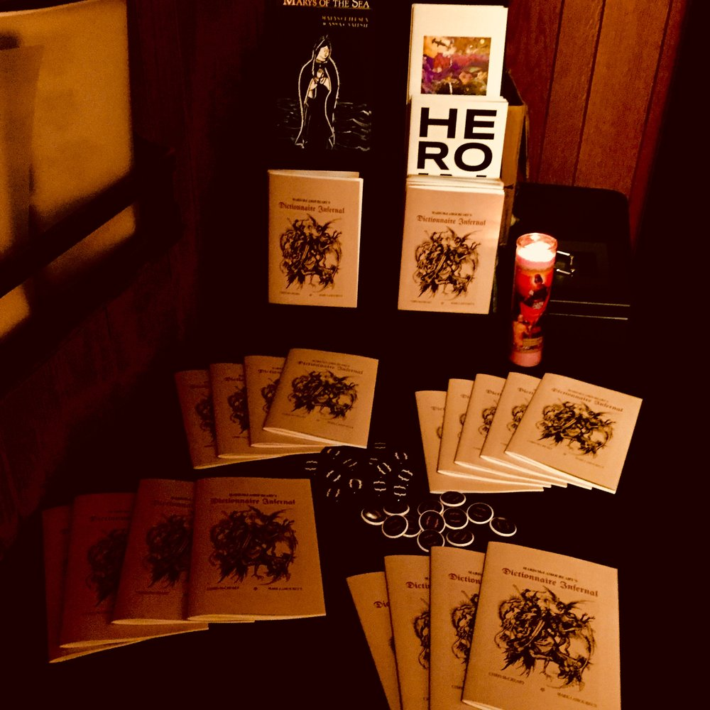 Merch at the Dictionnaire Infernal release party.