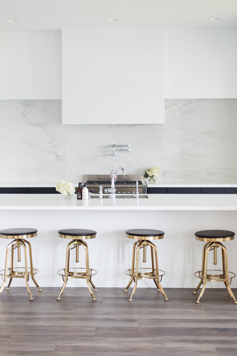 Restoration Hardware Bar Stools    | Island is made of    Corian in Arctic White
