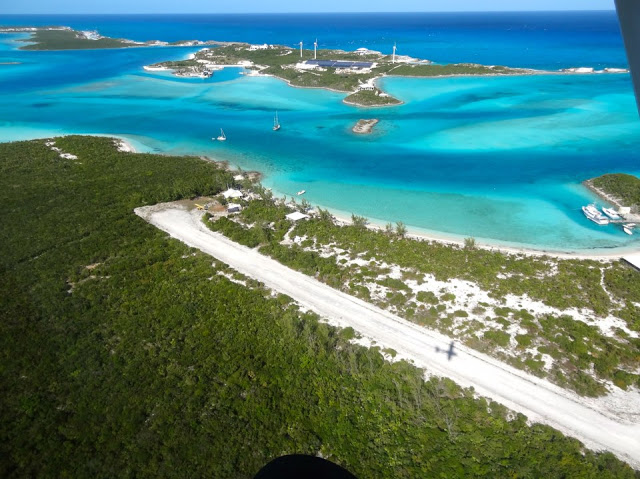 Shadow landing on Little Darby Cay. Over Yonder Cay in the distance source:out island flyers