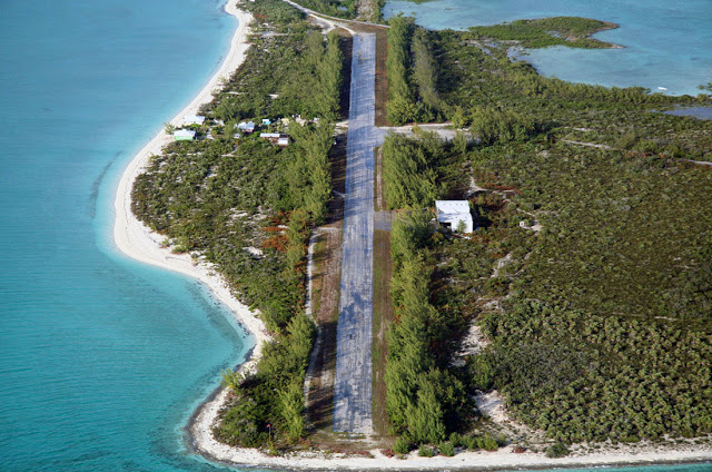 The old airstrip at Norman's Cay. Runway was recently extended and the wind-blocking Casuarinas were cut down source:airliners.net