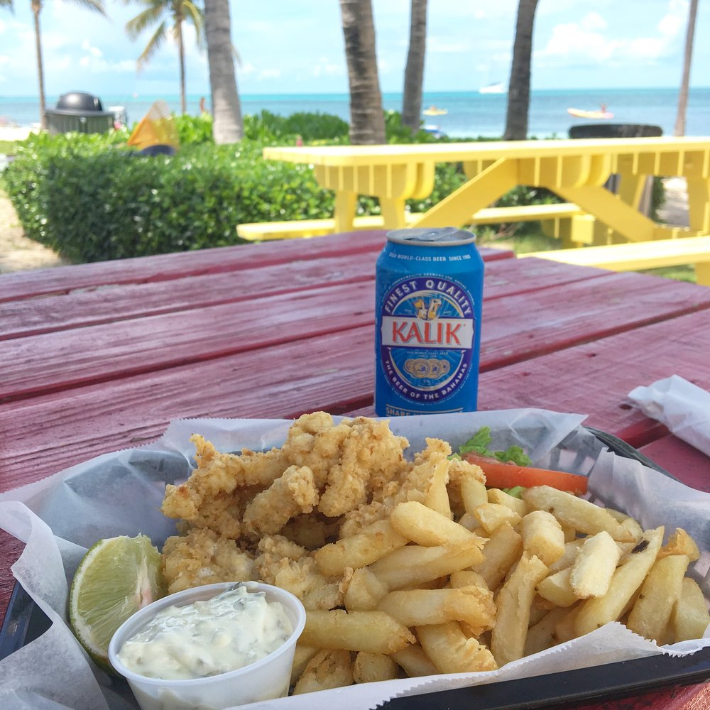 Cracked conch and cold beer at Old Bahama Bay