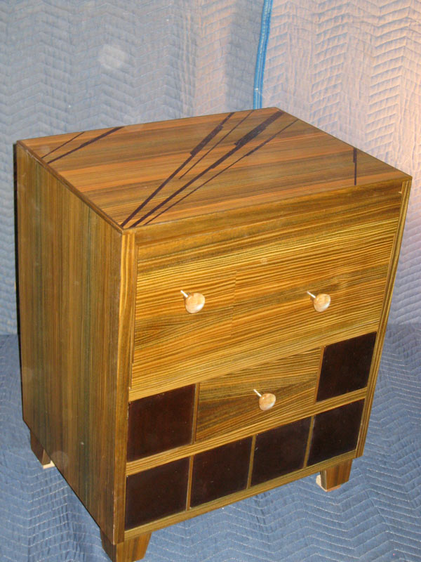 "Vera Wood Nightstands with clear vertical grain glass tile inlayed into front. Wenge wood inlayed into the tops at different widths at angles. 24""w x 18""d x 27""h"
