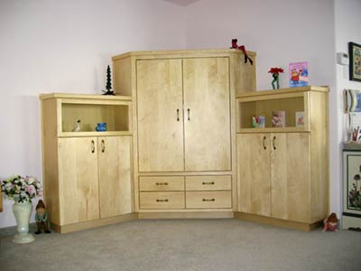 "Maple Entertainment Center with drawers for CDs and DVDs. 66"" x 66"" x 60""h"