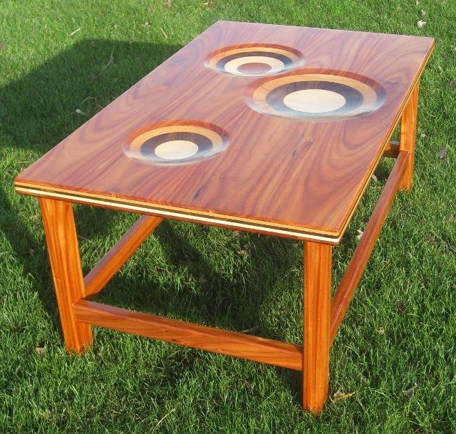 """Coffee table made from five different woods: Monkey wood, Cherry, Walnut, Maple and African Mahogany. The scoops and the edge depict the 5 layers. 45"""" x 27"""" x 20"""""""