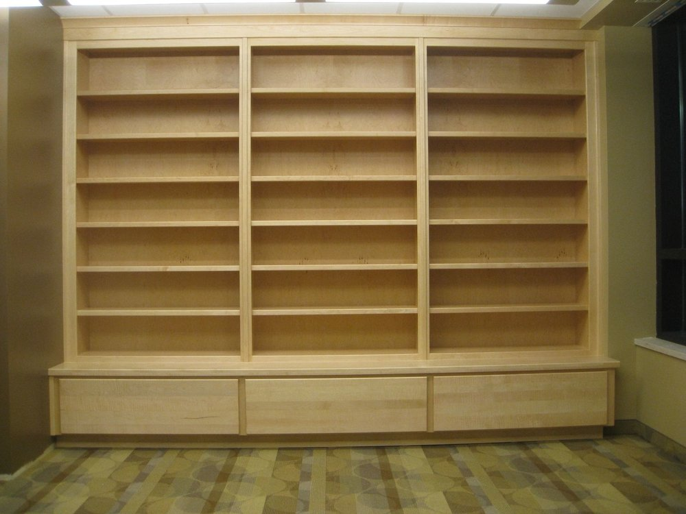 "Hard Rock Maple 135"" wide x 108"" high lower section is 22"" deep, bookcase section is 12"" deep"