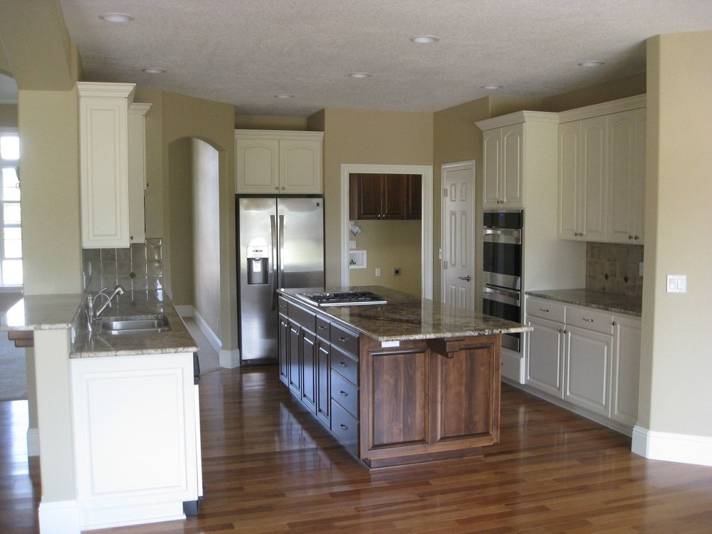Custom kitchen made from paint grade materials then covered in an Almond color paint. The island is made from Alder and stained dark with a lacquer finish.