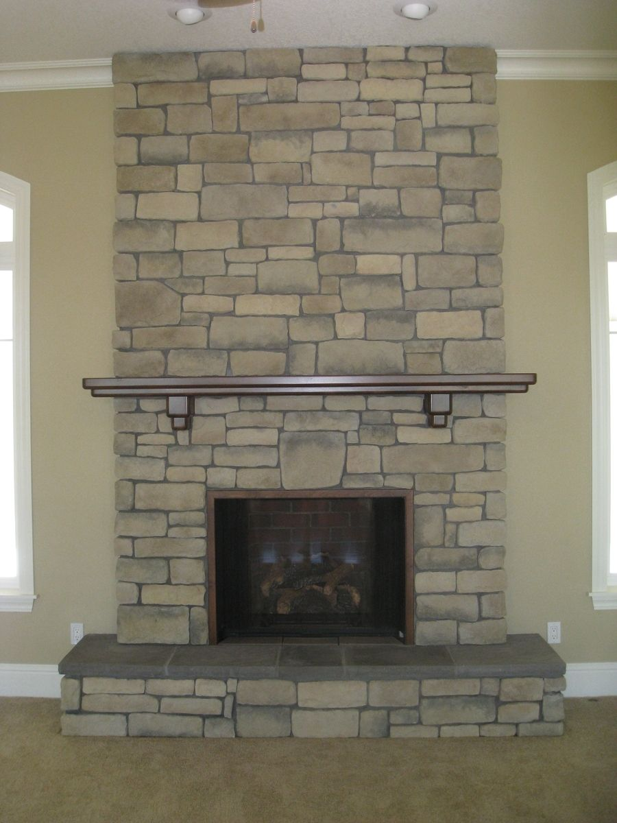 The fireplace mantle made from Alder and stained dark with a lacquer finish.