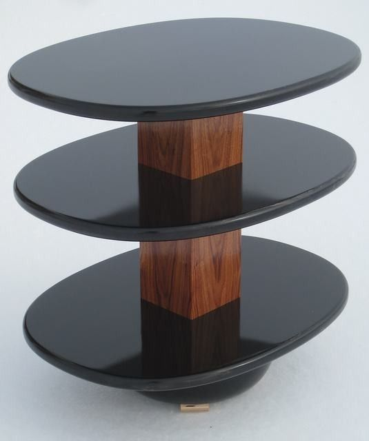 """End table three flat surfaces made from Poplar and painted black with a few coats of clear gloss lacquer. The center post is made from Monkey Wood and finished with clear lacquer.19 1/2"""" wide by 25 3/4"""" deep by 24 3/8"""" high"""