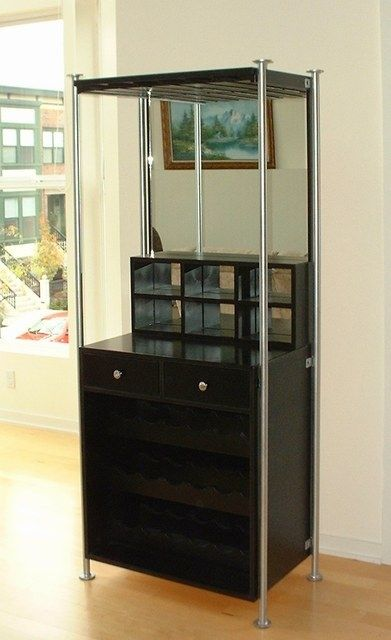 """Four posts welded with big metal washers for feet and the top, and a couple of mounting brackets to attach the cabinet to. Painted the posts silver and the cabinet body black.36""""w x 20""""d x 78""""h"""