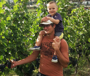 "Vineyard manager Scott Ingram, with a little ""help"", reviews grapes destined for Perseus wines."