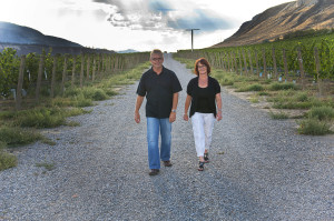 Harper's Trail owners Ed and Vicki Collett walk through their Thadd Springs vineyard in Kamloops  (photo by Linda Williams)