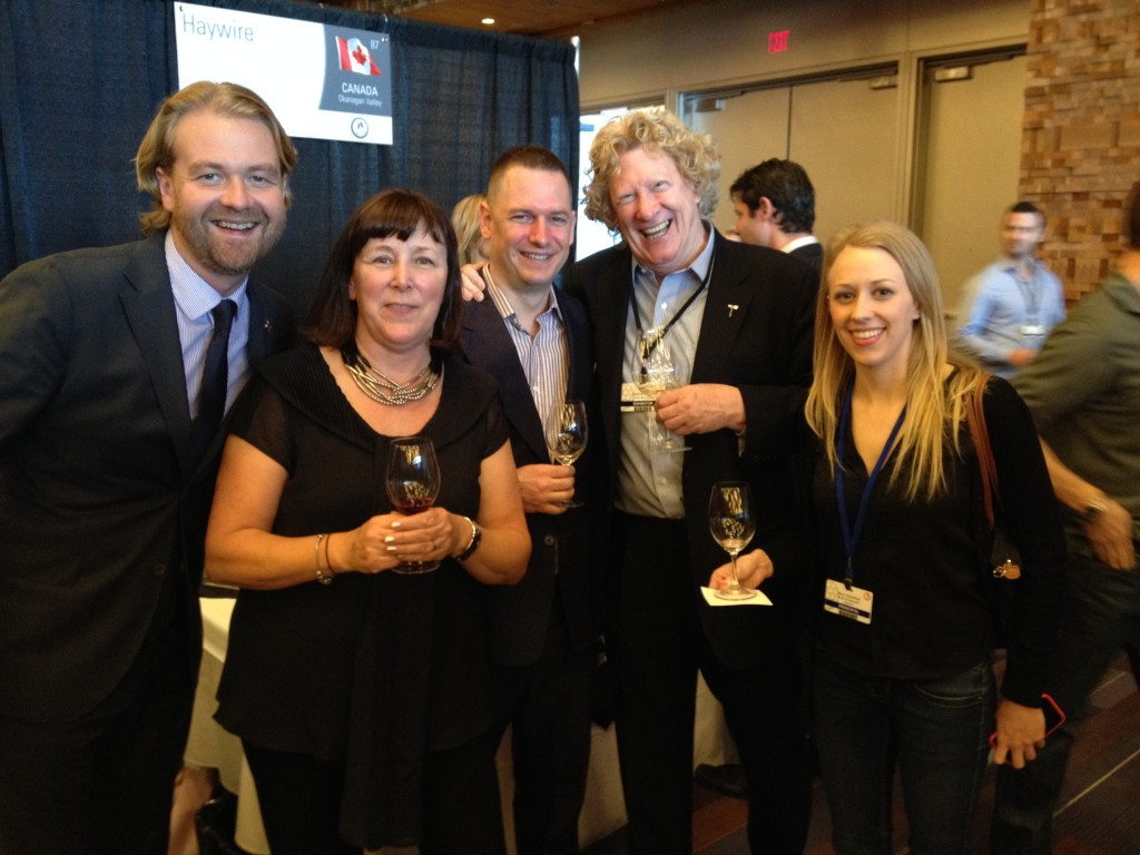 2012 Sommelier of the Year Terry Threlfall (left) and 2014 Sommelier of the Year Mike Bernardo (third from left) stop by the Okanagan Crush Pad table to say hello to Christine Coletta, David Scholefield, and Alison Scholefield