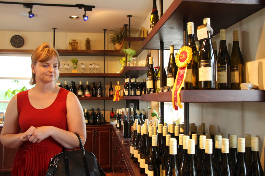 Laurisha makes her selections in the cozy and welcoming Mt. Boucherie wine shop