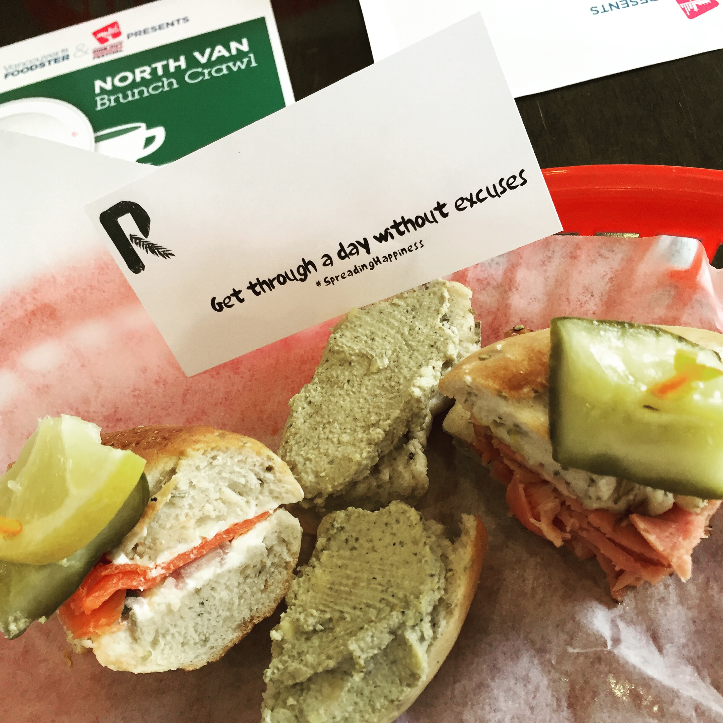 Dill pickle lox and cream cheese on poppyseed bagel with capers, red onion, lemon and dill pickle / vegan cashew spread on rosemary rocksalt bagel / Montreal smoked meat sandwich on sesame bagel with mustard