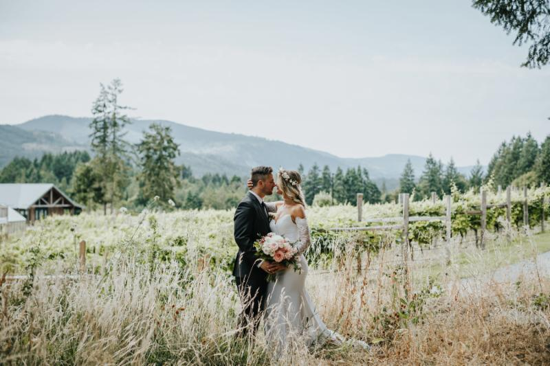 The Bride and Groom   share   a sweet moment on site at Blue Grouse Estate Winery. Photo Credit: Sweet Heirloom Photography