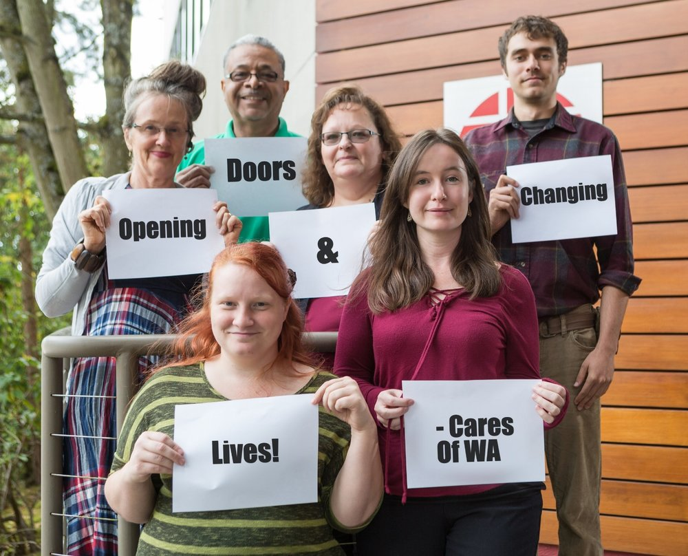The Cares Difference - Staff holding Motto