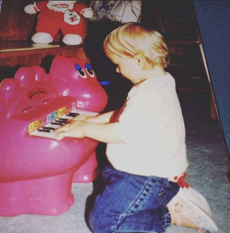 One and half year old me making up songs on my Barney piano.