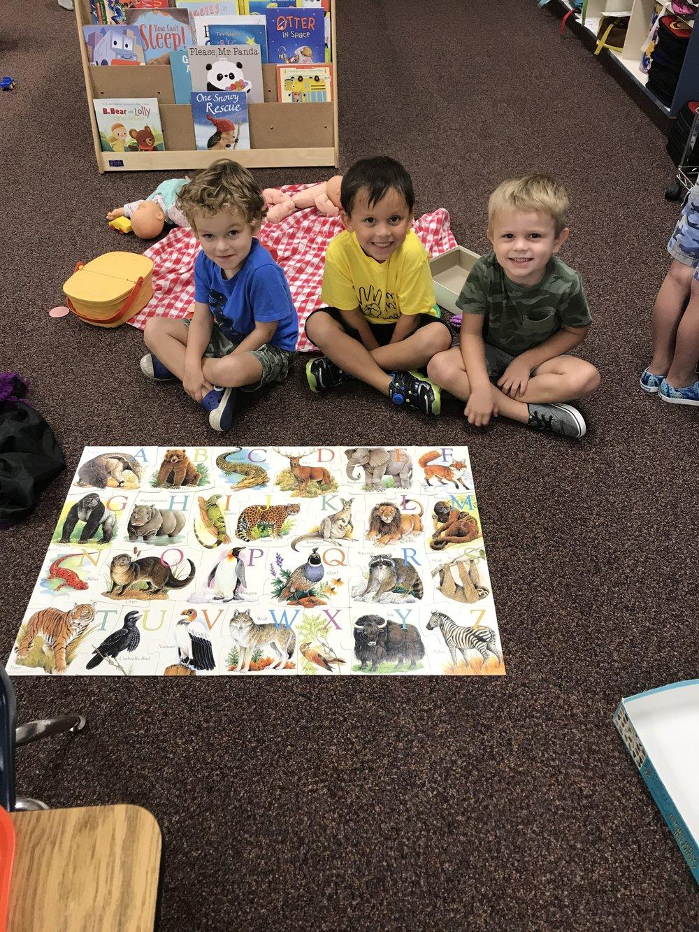 preschool children doing puzzle